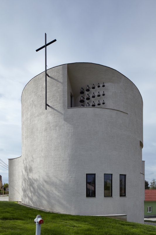 exterior view with cross and bells