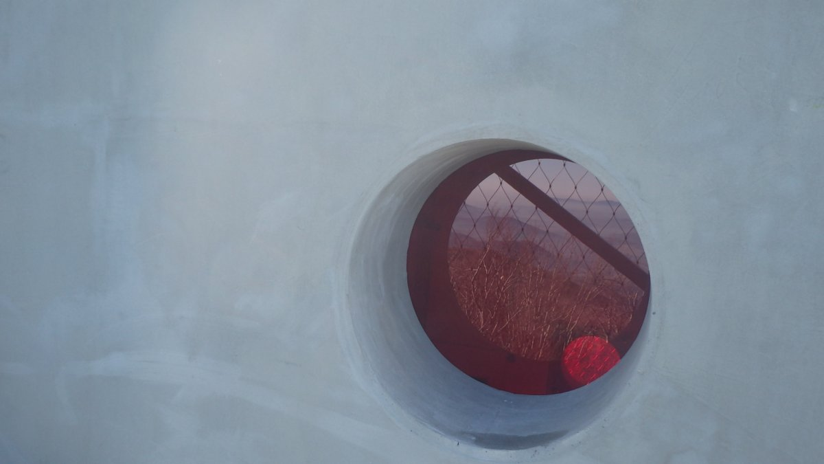 roundshaped coloured window from stairs